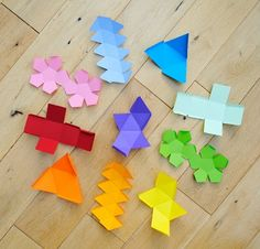 A fun paper craft, a painless lesson in symmetry and mathematics, an easy way to introduce a pop of color, and an excuse to say the word dodecahedron