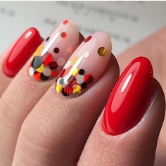 You look very elegant with dots in different colours on some nails.
