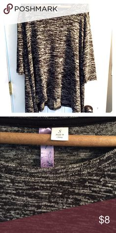 Oversized short sleeve sweater NWOT. Never worn- so cute and oversized. Thin enough to take into early spring and fall, and cute layered for winter. Short sleeves. Fits sizes small and medium Francesca's Collections Tops