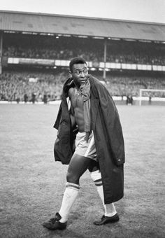 An injured Pele trudges from the Goodison Park pitch after watching Brazil lose 3-1 to Portugal in the second round of the 1966 World Cup