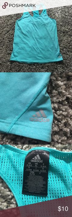 Adidas Workout Tank Like new!! Perfect for going to the gym or just hot summer days. The fabric is soft and stretchy, and would definitely fit a large as well. adidas Tops Tank Tops