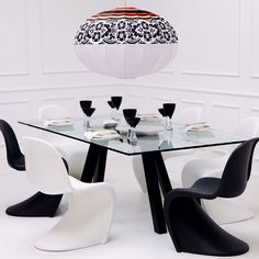Vitra Panton Dining Chair - The Panton Chair has been through a number of production phases since its original launch. Pairs nicely with the Black Brittany Dining Table & is available in several colors. http://www.occa-home.co.uk/vitra-panton-dining-chair