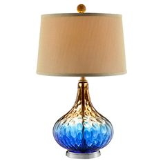 Showcasing a textured glass base in cobalt blue and gold, this lovely table lamp is a perfect addition to your nightstand or credenza.