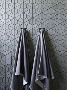 The darker grout in this shower emphasizes not only the pattern but the darker undertones of the tile.
