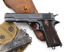 """Colt Model of 1911 U.S. Army .45 ACP serial number 137309 (ca. 1916) - This Colt 1911 was one of 500 pistols (136901 - 137400) shipped to San Antonio Arsenal, San Antonio, Texas on December 16, 1916. Accompanying M1912 holster is marked """"STATE OF TEXAS"""" on the flap and on the swivel. Also accompanying this pistol is a pair of Type I lanyard loop magazines."""