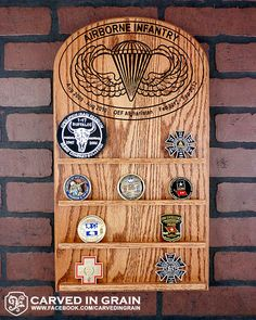 Large wall hanging Challenge Coin Rack with Airborne Jump Wings, customized with deployment dates and locations. Carved from Oak wood for long standing durability.  www.etsy.com/shop/carvedingrain