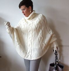The poncho! The new fashion favorite! The great color of ivory cream! Absolutely alluring when it swirls around the body with every step you take. Just slip into this beauty and show your legs in cigarette pants or leggings and high heels. Soo chic! Feel like a celebrity in your very own