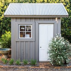 Corrugated Roofing Garage and Shed Farmhouse with Board and Batten Siding Corrugated Metal Roof Cute Shed Corrugated Roofing, Corrugated Metal, Shed Design Plans, Shed Plans, House Plans, Metal Sheds For Sale, Cabana, Farmhouse Sheds, Grey Siding