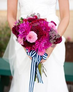 Mixed blooms, which were sourced locally, get a striped navy ribbon for Melody's Washington state wedding.