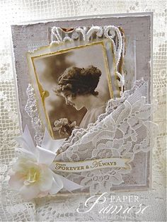 Paper Primrose ~ vintage woman, layers of papers/fabrics/lace.  Double bow with flower, whites, creams and tans.  Vintage, shabby chic card