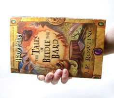 What fun for a Harry Potter fan - a Book Clutch Purse handcrafted from recycled book, The Tales of Beedle the Bard.