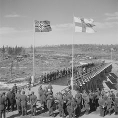 A newly built bridge built across the River Sohjana at Kiestinki, Finland, with German and Finnish flags waving above it (January Modern Photographers, Ww2 History, Over The River, Military Photos, Historical Images, World War Two, Finland, Wwii, Nostalgia
