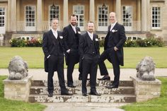 Groomsmen in black suits with pale pink ties and pale pink roses as buttonholes buttonieres. Buxted Park Hotel wedding photography. Sussex wedding at Buxted Park Hotel. Beautiful English countryside. By Dennison Studios Photography. Wedding inspiration.
