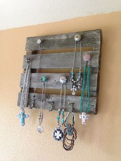 My homemade jewlery holder :) found the wood at an antique store and added the hooks and knobs... Really loving that I did this :)