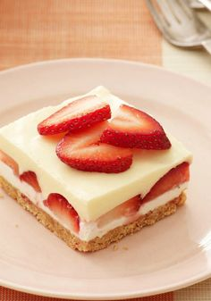 Creamy Layered Lemon Squares – Creamy lemon and fresh strawberry layers make every bite a luscious mix of bright citrus and sweet berry.