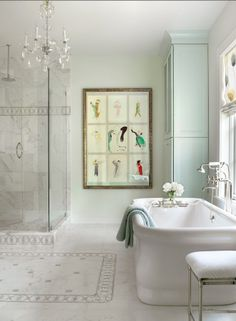 Beautiful feminine master suite bath with pop of color