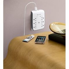 Belkin 6 Outlet Surge Protector with USB -- wouldn't this be handy with all our devices that need a USB port for charging?