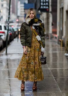 Browse the best street style looks from NYFW Fall 2017 via @STYLECASTER | boho maxi dress, olive puffer jacket