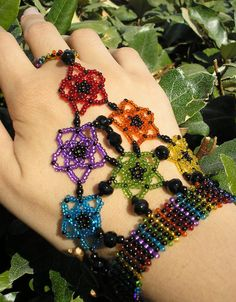 Items similar to Slave to Pride - seed beaded slave bracelet on Etsy Hand Jewelry, Seed Bead Jewelry, Bead Jewellery, Jewelry Making Beads, Jewelry Crafts, Handmade Jewelry, Wire Jewelry, Seed Beads, Beaded Rings