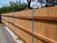 steel posts on wooden fence - Google Search