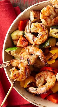 Freshen up this traditional Italian salad by adding sweet peppers and zucchini to its usual mix of stale bread and fresh tomatoes. Grilled shrimp adds protein while keeping this dish low-cal.