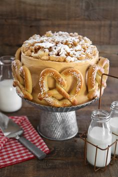 State Fair Sampler Cake - caramel apple upside down cake + sweet maple cornmeal cake + oreo cake with salted dulce de leche frosting topped with soft pretzels and funnel cake