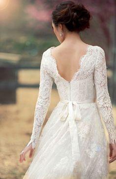 Elegant white long-sleeve lace wedding dress; Featured Photographer: Jana Williams