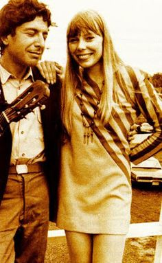 a young Leonard Cohen with Jonie Mitchell.. Newport Folk Festival 1967