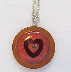 A personal favorite from my Etsy shop https://www.etsy.com/listing/506279771/resin-and-wood-red-heart-pendant