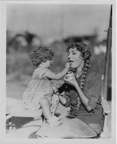 Silent movie actress Mary Pickford with tiny costar Mary Louise Miller on the set of Sparrows (1926)