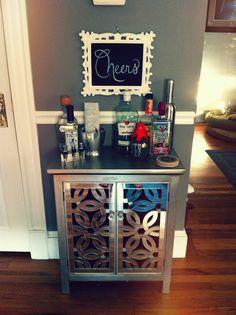 Mini bar - maybe with wine racks above instead? Hard liquor in cabinet