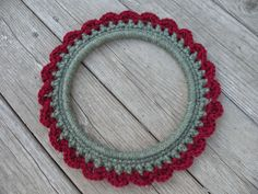 This handmade crochet wreath is a perfect addition to your home decor. Use as wall or table decor!