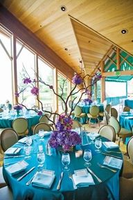 Airy reception with teal and purple accents.