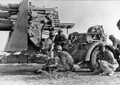 AfkrikaKorps anti-tank crew near Bei Bir Harmat, Libya prepare to fire their 88mm Flak gun being used in an anti-tank role. The 88mm was literally murderous against all sorts of armor as well as stationary targets and was used extensively in the desert war.