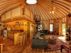 Yurt enthusiasts favor the design of these tent-like homes because of the large, open feeling of the interior space and the possibilities they offer in terms of decoration and social activities. This model from Blue Ridge Yurts is a good example of a yurt that is ideal for a family vacation or summer home.
