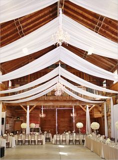 Love the little chandeliers -- glass contrasting with wood.  All decorations in white.