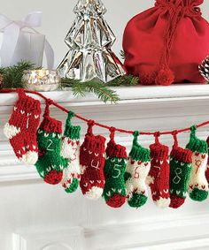 Knit Stocking Garland.  I'm totally going to make one for my advent calendar this year!