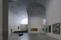 vaulted concrete forms shape long museum west bund by atelier deshaus