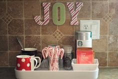 Love the letters on the wall.  The hot chocolate station isn't a bad idea either.
