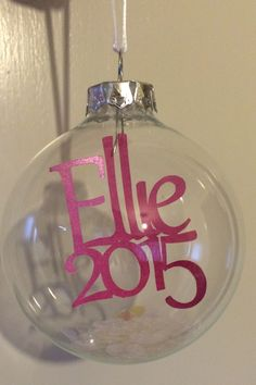 New Baby Bauble. A glass bauble with a delicate personalised Papercut placed inside.