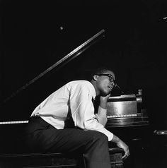Pianist Herbie Hancock relaxes on the piano bench during the recording session for Donald Byrd's Chant album.