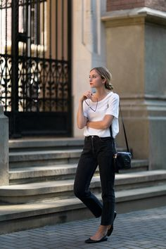 White t-shirt, cropped black jeans, black flats and black Gucci purse.