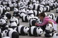 WWF Germany placed 1,600 panda bear sculptures in front of Berlin's main train station to draw attention to the plight of the endangered species.  Photo credit: Reuters