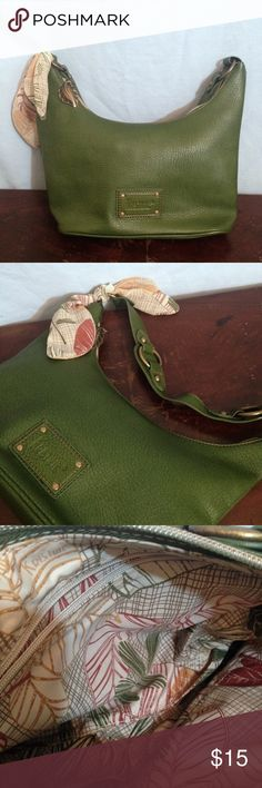 """Kristine Forest Green Vegan Leather Purse Kristine forest green vegan leather purse. Inside zippered pocket and 2 slip pockets, botanical print fabric lining. Small matching accent scarf at base of strap, and decorative metal leaf pull on exterior zipper. Measurements: 10 1/2"""" wide, 5"""" deep, 7"""" high, 12 1/2"""" drop. Kristine Bags"""
