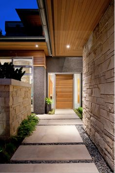 POSSIBLE NEW FRONT DOOR. POSSIBLY THIS TYPE OF WALKWAY WITH RECTANGULAR CONCRETE PADS AND GREY OR BLACK ROCKS BETWEEN THE CONCRETE.
