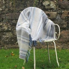 "Color: Blue with GreyThis beautiful throw blanket measures 54 inches by 71 inches including a 3"" rolled fringeMade form a blend of 10% cashmere and 90% merino wool resulting in a super soft throw. The traditional weave makes it warm a..."
