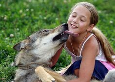 Affection: She can also roll about in the grass with them and even take a kiss on the chee...