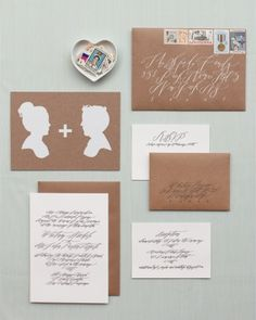Artist Erik Johnson's silhouettes of the couple were screen-printed onto kraft-paper save-the-dates. The rest of the suite featured free-flowing calligraphy, and the envelopes were adorned with old-timey stamps.