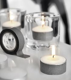 put decorative tape on tea light candles for a quick and cute d.i.y. way to decorate your table or room