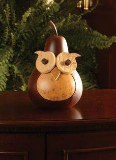 """2015 - Our wise old owl, Professor, is the perfect fall decoration. He would make a great gift, especially for a teacher. He is walnut and natural in color. He is approximately 5"""" in diameter."""